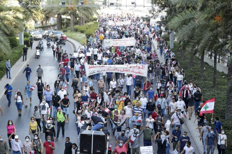 Protesters march on the fortified headquarters of Lebanon's central bank whose policies have been widely blamed for the country's plummeting currency and ballooning sovereign debt