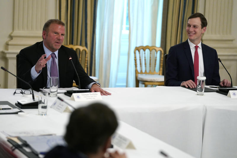 Tilman Fertitta, chairman and CEO of Landry's Inc., speaks during a meeting with restaurant industry executives about the coronavirus response, in the State Dining Room of the White House, Monday, May 18, 2020, in Washington, as White House senior adviser Jared Kushner listens. (AP Photo/Evan Vucci)