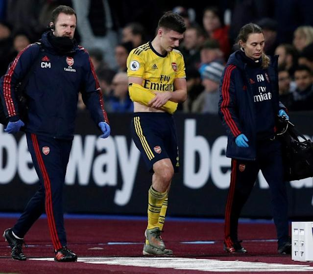 Kieran Tierney is expected to miss three months of action due to a dislocated shoulder (AFP Photo/Adrian DENNIS)