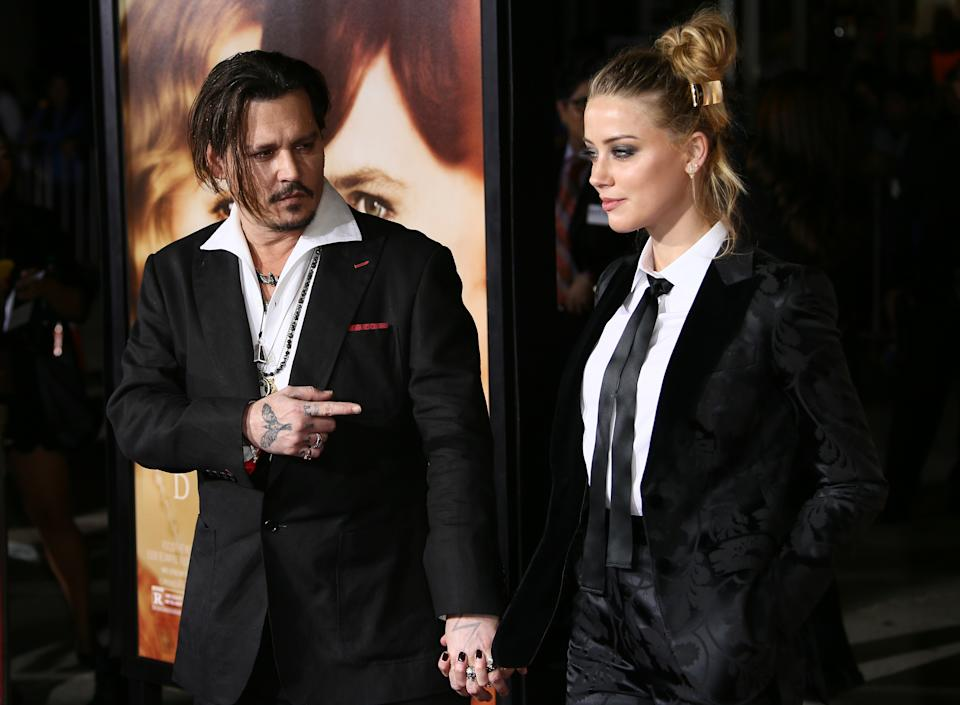 WESTWOOD, CA - NOVEMBER 21: Amber Heard and Johnny Depp attend the premiere of Focus Features' 'The Danish Girl' on November 21, 2015 in Westwood, California. (Photo by JB Lacroix/Getty Images)