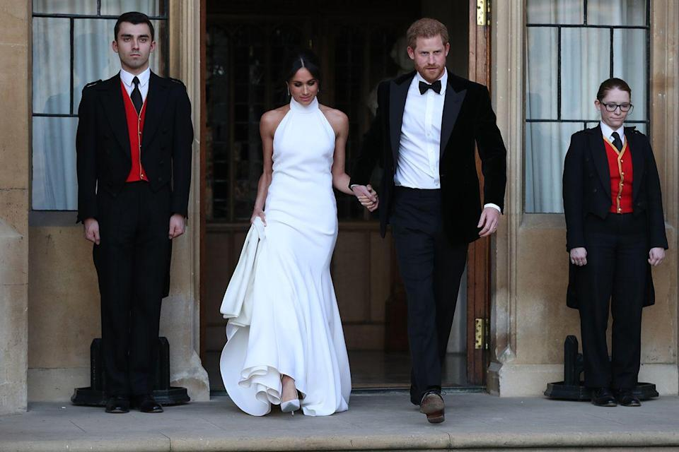"""<p>Meghan reportedly broke royal protocol by <a href=""""https://www.marieclaire.com/celebrity/a20763519/meghan-markle-prince-harry-wedding-reception-news/"""" rel=""""nofollow noopener"""" target=""""_blank"""" data-ylk=""""slk:giving a speech at her and Harry's reception"""" class=""""link rapid-noclick-resp"""">giving a speech at her and Harry's reception</a>. The speech was directed at her royal in-laws for welcoming her into the family. </p>"""