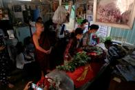 People attend the funeral of Kyaw Win Maung, who was shot and killed during a protest against the military coup, in Mandalay