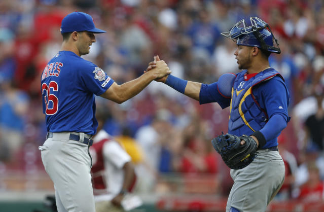Chicago Cubs relief pitcher Dillon Maples, left, and catcher Willson Contreras celebrate their win over the Cincinnati Reds in a baseball game, Saturday, June 29, 2019, in Cincinnati. (AP Photo/Gary Landers)