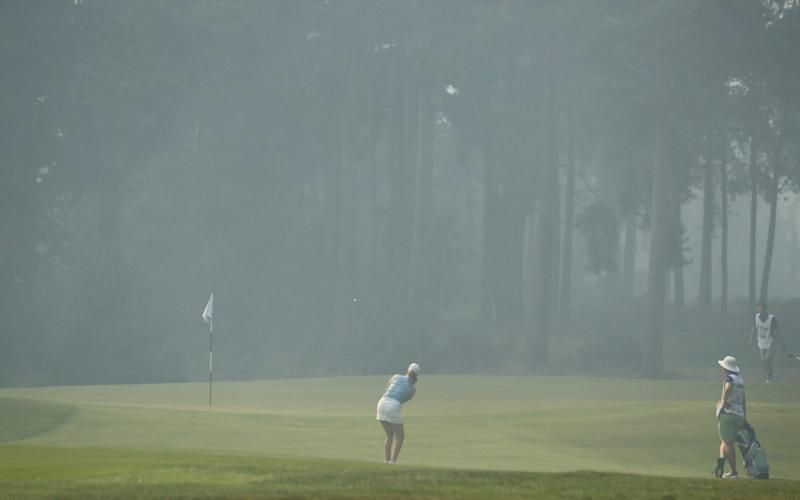 Players attempted to continue as smoke engulfed the course - GETTY IMAGES