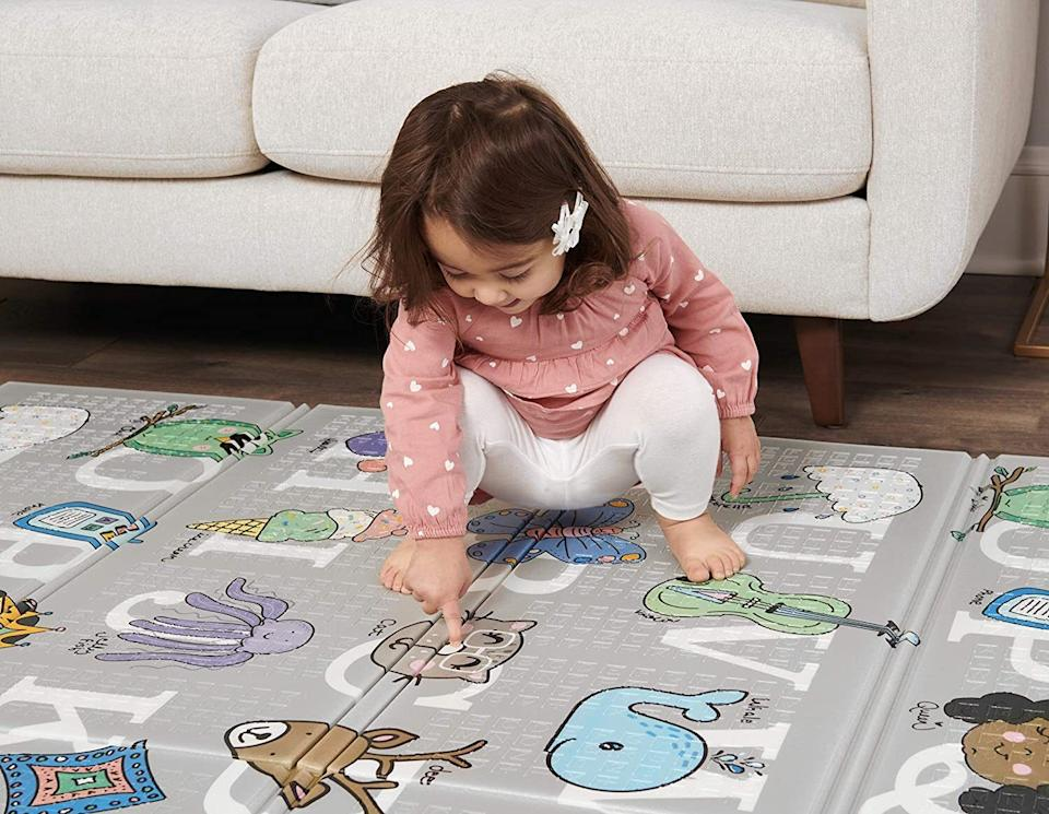"This mat has it all: It's foldable, reversible and waterproof.<br /><br /><strong>Promising review:</strong> ""If you've got hardwood floors and neighbors below, you're going to get a lot of use out of this mat. It's so much better than a rug when it comes to cushioning all the trips and falls of a toddler. Big bonus: two different designs. <strong>One side features colorful animals matched with letters of the alphabet; the other side is a simple white pattern, which kind of reminds me of Joy Division's <i>Unknown Pleasures</i> </strong>(you've probably seen the T-shirt). This mat gets a daily workout, and I'm not really sure what we did without it."" — <a href=""https://www.buzzfeed.com/jmihaly"" target=""_blank"" rel=""noopener noreferrer"">John Mihaly</a><br /> <br /><strong>Get it from Amazon for<a href=""https://amzn.to/2OT1cJ9"" target=""_blank"" rel=""noopener noreferrer""> $44.99</a>.</strong>"