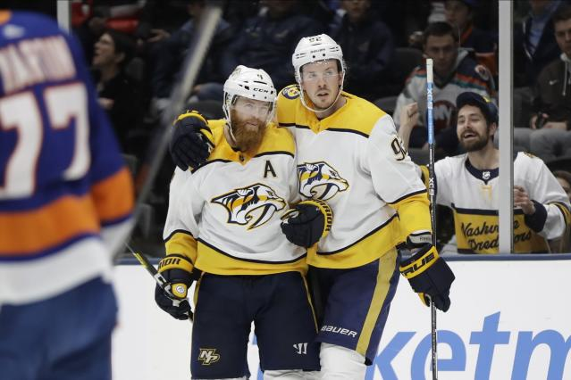 Nashville Predators' Ryan Johansen, right, celebrates with teammate Ryan Ellis after scoring a goal during the third period of an NHL hockey game against the New York Islanders Tuesday, Dec. 17, 2019, in Uniondale, N.Y. The Predators won 8-3. (AP Photo/Frank Franklin II)