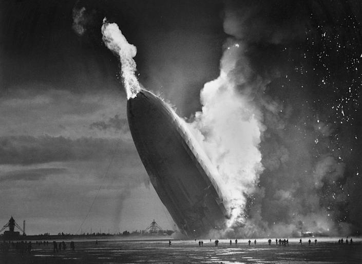"""<p>In this May 6, 1937 file photo, the German dirigible Hindenburg crashes to earth in flames after exploding at the U.S. Naval Station in Lakehurst, N.J. Only one person is left of the 62 passengers and crew who survived when the Hindenburg burst into flames 80 years ago Saturday, May 6, 2017. Werner Doehner was 8 years old when he boarded the zeppelin with his parents and older siblings after their vacation to Germany in 1937. The 88-year-old now living in Parachute, Colo., tells The Associated Press that the airship pitched as it tried to land in New Jersey and that """"suddenly the air was on fire."""" (AP Photo/Murray Becker, File) </p>"""