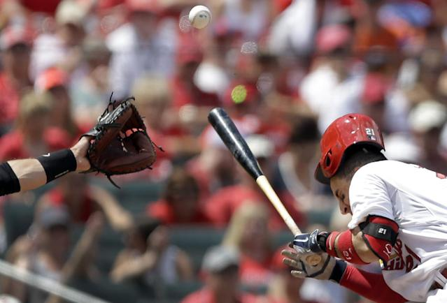 St. Louis Cardinals' Allen Craig recoils after being hit in the head by a pitch during the third inning of a baseball game against the San Francisco Giants, Sunday, June 1, 2014, in St. Louis. Craig was able to stay in the game. (AP Photo/Jeff Roberson)