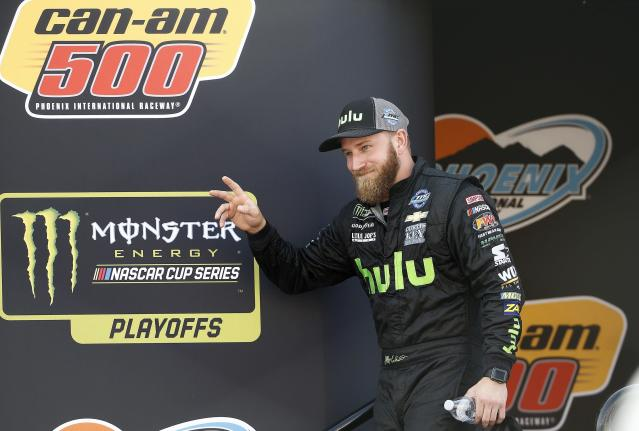 "<a class=""link rapid-noclick-resp"" href=""/nascar/nationwide/drivers/1543"" data-ylk=""slk:Jeffrey Earnhardt"">Jeffrey Earnhardt</a> waves to the crowd during driver introductions prior to a NASCAR Cup Series auto race at Phoenix International Raceway Sunday, Nov. 12, 2017, in Avondale, Ariz. (AP Photo/Ross D. Franklin)"