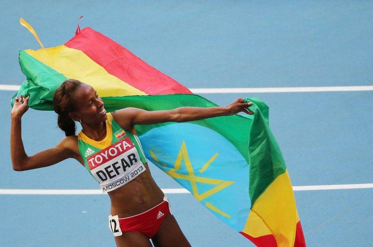 Meseret Defar celebrates at the Luzhniki stadium in Moscow on August 17, 2013