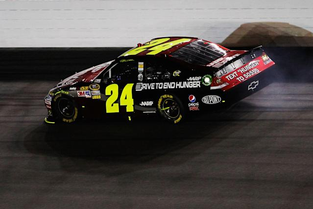 DAYTONA BEACH, FL - FEBRUARY 27: Jeff Gordon, driver of the #24 Drive to End Hunger Chevrolet, stays off the wall after an engine failure during the NASCAR Sprint Cup Series Daytona 500 at Daytona International Speedway on February 27, 2012 in Daytona Beach, Florida. (Photo by Streeter Lecka/Getty Images)