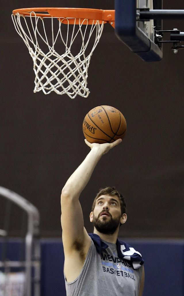 Memphis Grizzlies center Marc Gasol warms up during practice Friday, April 25, 2014, in Memphis, Tenn. The Grizzlies face the Oklahoma City Thunder on Saturday in Game 4 of their opening-round NBA basketball playoff series. The Grizzlies lead the series 2-1. (AP Photo/Mark Humphrey)