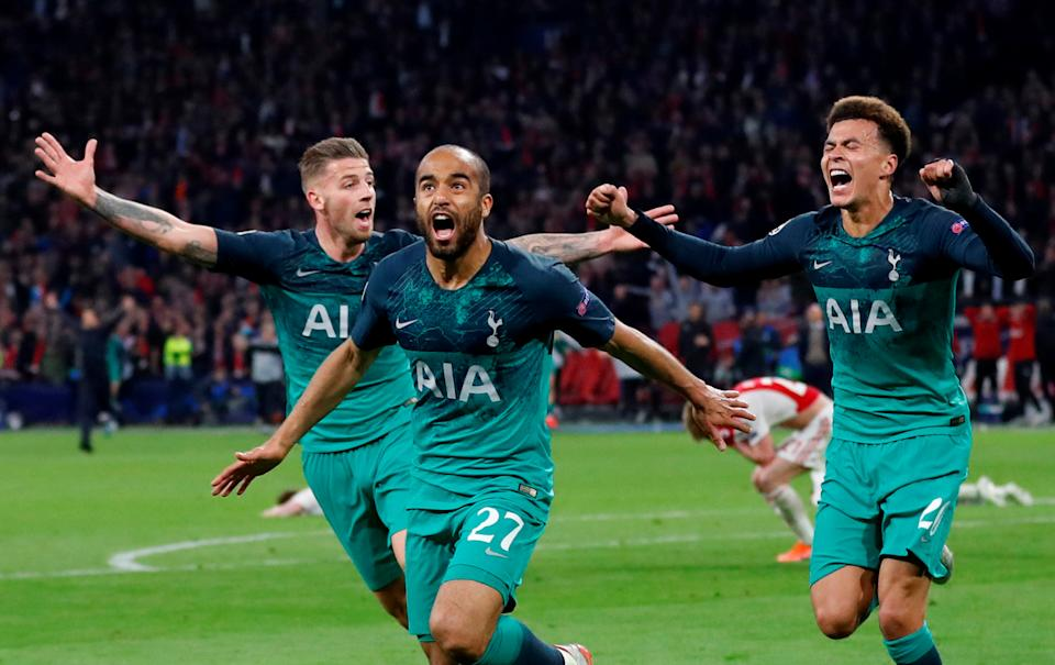 Soccer Football - Champions League Semi Final Second Leg - Ajax Amsterdam v Tottenham Hotspur - Johan Cruijff Arena, Amsterdam, Netherlands - May 8, 2019  Tottenham's Lucas Moura celebrates scoring their third goal to complete his hat-trick with Dele Alli and Toby Alderweireld   Action Images via Reuters/Matthew Childs