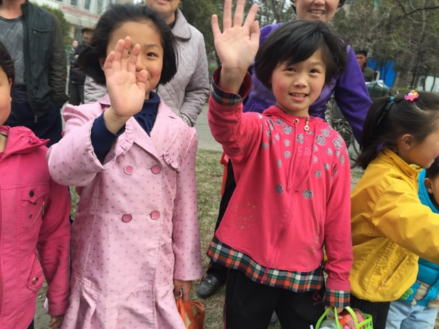 Children line the streets of Pyongyang to cheer on the marathon runners. (Courtesy Kathy Whitmer)