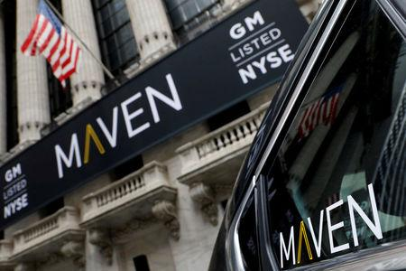FILE PHOTO: A sign for General Motors Co. car-sharing operation, Maven hangs on the facade of the New York Stock Exchange (NYSE) in New York, U.S., May 15, 2017. REUTERS/Brendan McDermid/File Photo