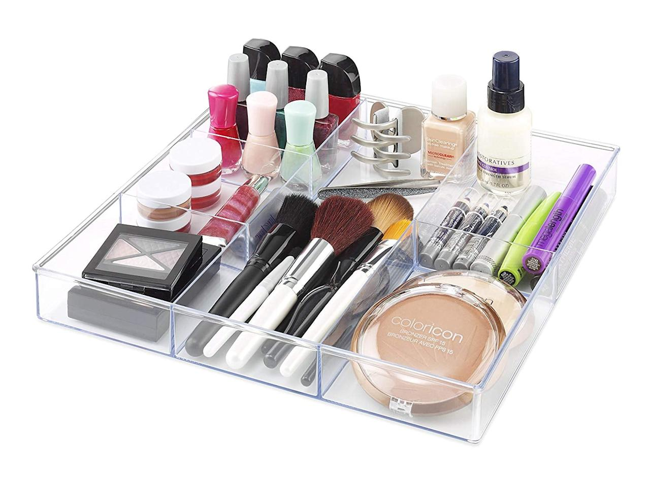 "<p>Clean up your cosmetics with this <a href=""https://www.popsugar.com/buy/Whitmor-6-Section-Drawer-Organizer-475127?p_name=Whitmor%206-Section%20Drawer%20Organizer&retailer=amazon.com&pid=475127&price=20&evar1=casa%3Aus&evar9=46525865&evar98=https%3A%2F%2Fwww.popsugar.com%2Fhome%2Fphoto-gallery%2F46525865%2Fimage%2F46525889%2FWhitmor-6-Section-Drawer-Organizer&list1=shopping%2Corganizing%2Corganization%2Chome%20organization%2Chome%20shopping&prop13=mobile&pdata=1"" rel=""nofollow"" data-shoppable-link=""1"" target=""_blank"" class=""ga-track"" data-ga-category=""Related"" data-ga-label=""https://www.amazon.com/Whitmor-Section-Drawer-Organizer-Clear/dp/B00AN8CTX0/ref=sr_1_11?crid=7NGQ9H974AF4&amp;keywords=drawer+organizer&amp;qid=1564765845&amp;s=gateway&amp;sprefix=drawer%2Caps%2C198&amp;sr=8-11"" data-ga-action=""In-Line Links"">Whitmor 6-Section Drawer Organizer</a> ($20).</p>"