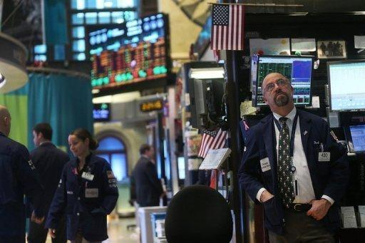 Traders work on the floor of the New York Stock Exchange on December 12, 2012