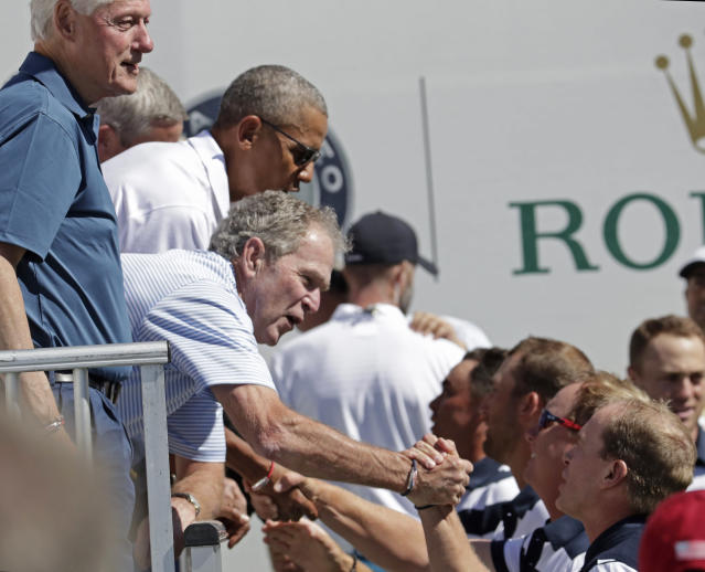 <p>Former Presidents Bill Clinton, George Bush and Barack Obama, greet the U.S. team before the first round of the Presidents Cup at Liberty National Golf Club in Jersey City, N.J., Thursday, Sept. 28, 2017. (AP Photo/Julio Cortez) </p>