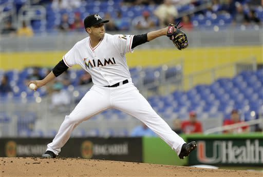 Miami Marlins' Alex Sanabia pitches to the Cincinnati Reds in the first inning of a baseball game in Miami, Wednesday, May 15, 2013. (AP Photo/Alan Diaz)