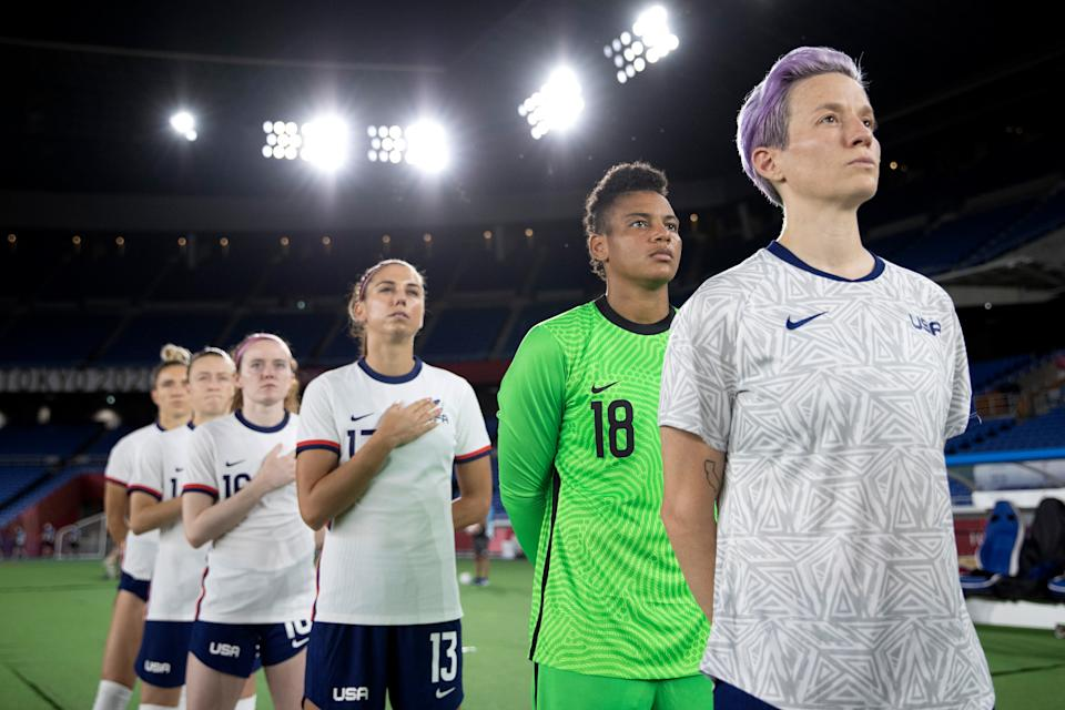 Megan Rapinoe (right) stands next to her United States teammates for the national anthem prior to their quarterfinal match against Netherlands on July 30. (Laurence Griffiths/Getty Images)