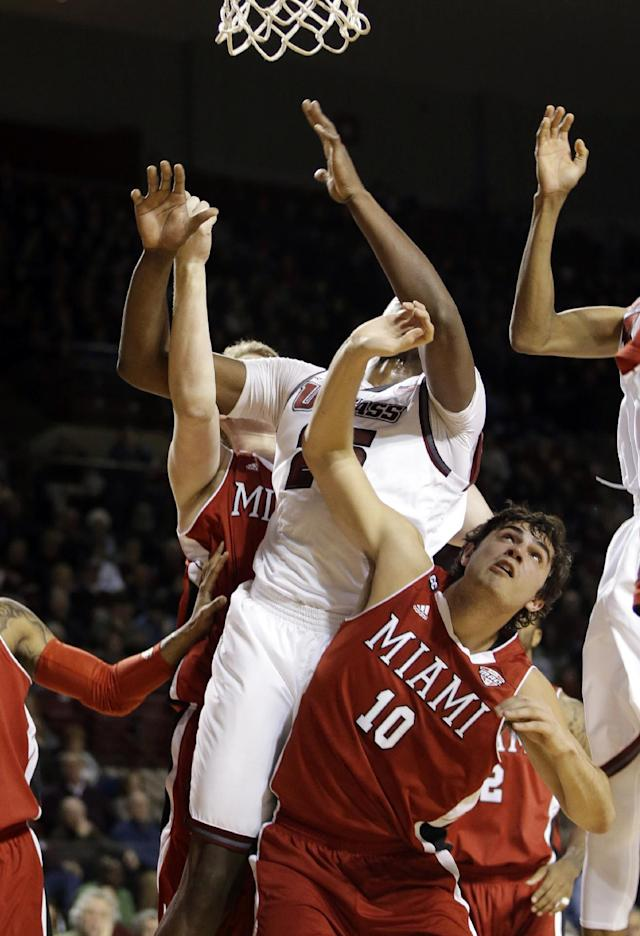 Miami (Ohio) forward Joshua Oswald (10) fights for position under the defensive boards during the first half of an NCAA college basketball game against Massachusetts in Amherst, Mass., Saturday, Jan. 4, 2014. (AP Photo/Stephan Savoia)