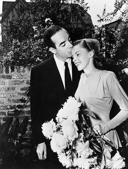 <p>Garland and her husband film director Vincente Minnelli pose for a shot at their wedding. The two met on the set of <em>Meet Me in St. Louis</em>, of which Minnelli was the director, and eventually had their daughter, Liza Minnelli, together.<br></p>