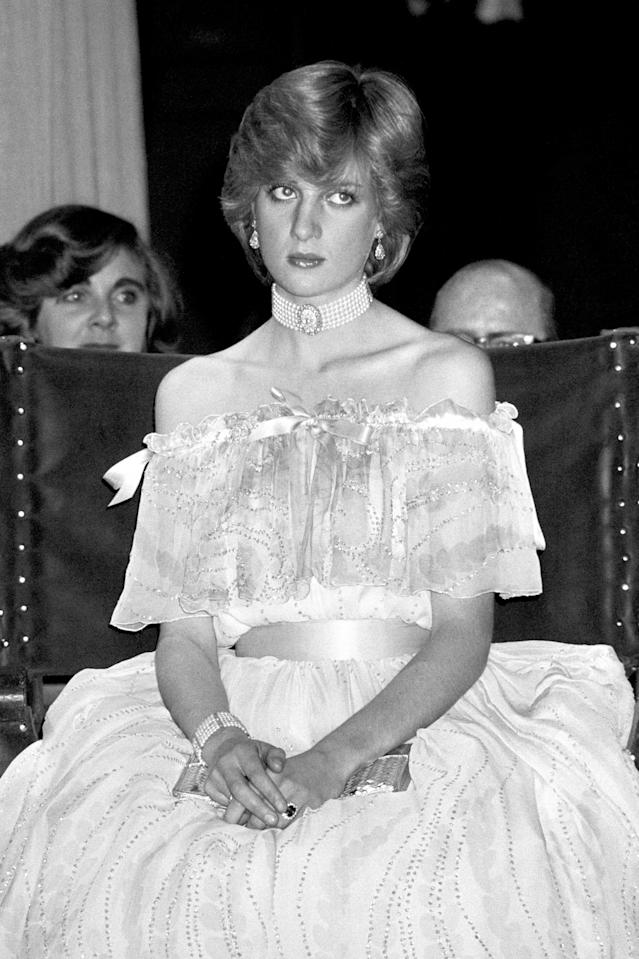 <p>Princess Diana is pictured here wearing a pearl choker with a cold-shoulder dress by Bellville Sassoon. The royal chose the outfit for a gala at the Victoria and Albert Museum in 1981. The following day, it was announced that the princess was expecting her first child. (Photo: PA) </p>