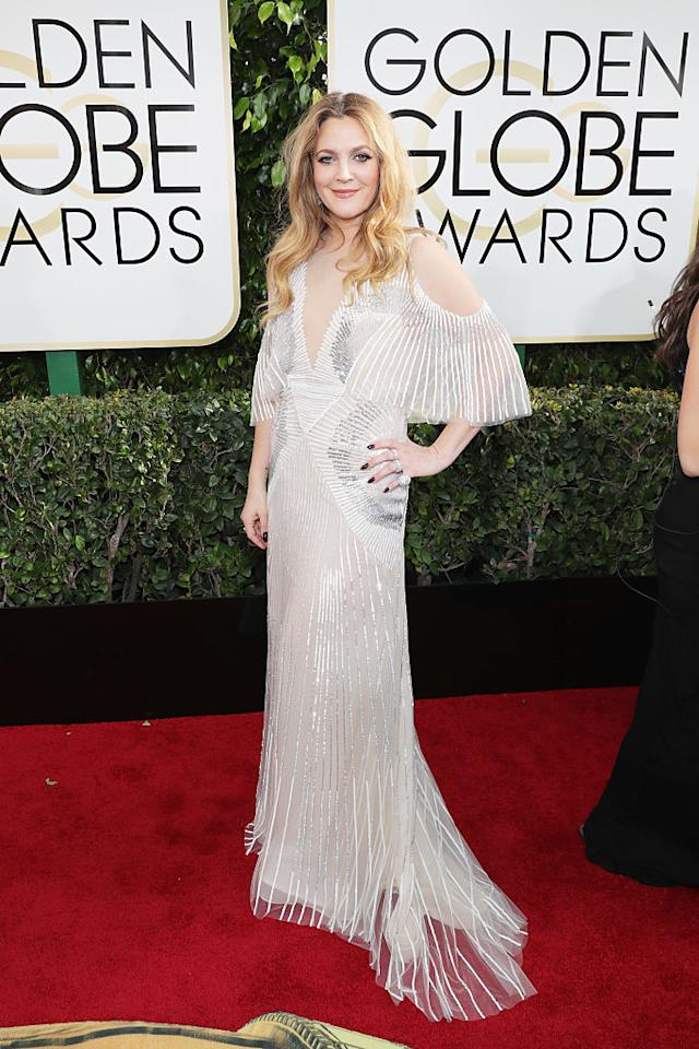 """<p>Genna commented that while she thought that Lily Collins's look was far and away the best of the night, she thought Drew Barrymore was """"stunning"""" as well in an ombré metallic Art-Deco-sunburst-embroidered, cape-sleeve sheath dress from designer Monique Lhuillier's spring 2017 collection. (Photo: Getty Images) </p>"""