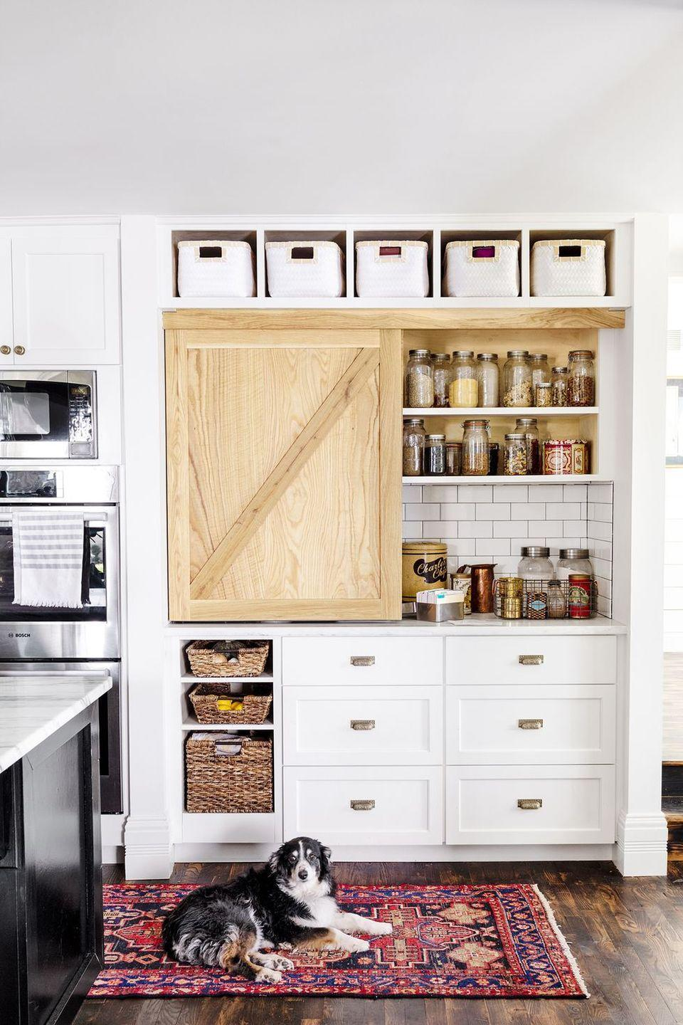 "<p>A combination of baskets and clear containers with lids can easily make your open <a href=""https://www.goodhousekeeping.com/home/organizing/g25560359/pantry-organization-ideas/"" rel=""nofollow noopener"" target=""_blank"" data-ylk=""slk:pantry look more polished"" class=""link rapid-noclick-resp"">pantry look more polished</a>. <br></p>"