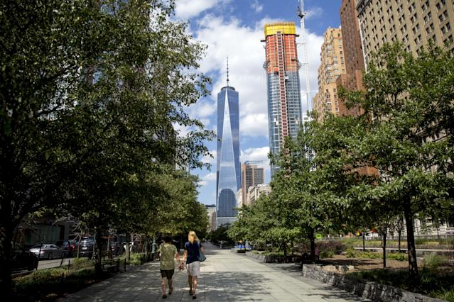 People walk along the Hudson River Greenway in New York City, Aug. 26, 2015. (Brendan McDermid / Reuters)