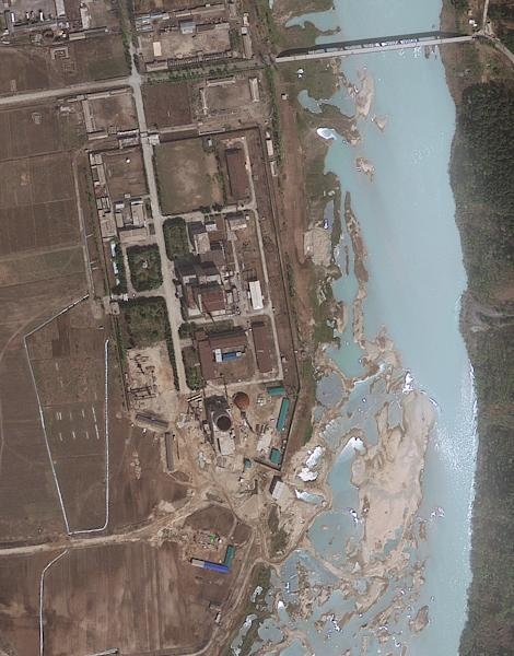 FILE - This April 30, 2012 file satellite image provided by GeoEye shows the area around the Yongbyon nuclear facility in Yongbyon, North Korea. The U.S.-Korea Institute at Johns Hopkins School of Advanced International Studies said on May 16, 2012, that new satellite imagery showed that North Korea had resumed building work on a reactor after months of inactivity at the site. The GeoEye image shows progress in construction of the containment building for the light-water reactor at the Yongbyon facility, according to the institute, but that the reactor is unlikely to become operational before 2014 or 2015. North Korean scientists have mastered domestic production of essential components for the gas centrifuges needed to build uranium-based nuclear bombs, apparently shutting down one of the few ways outsiders could monitor secretive atomic work, according to evidence gathered by two American experts, The Associated Press reports Monday, Sept. 23, 2013. (AP Photo/GeoEye, File)