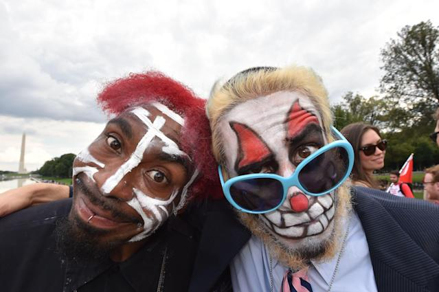 <p>Fans of the US rap group Insane Clown Posse, known as Juggalos, protest on Sept. 16, 2017 in front of the Lincoln Memorial in Washington, D.C. against a 2011 FBI decision to classify their movement as a gang. (Photo: Paul J. Richards/AFP/Getty Images) </p>