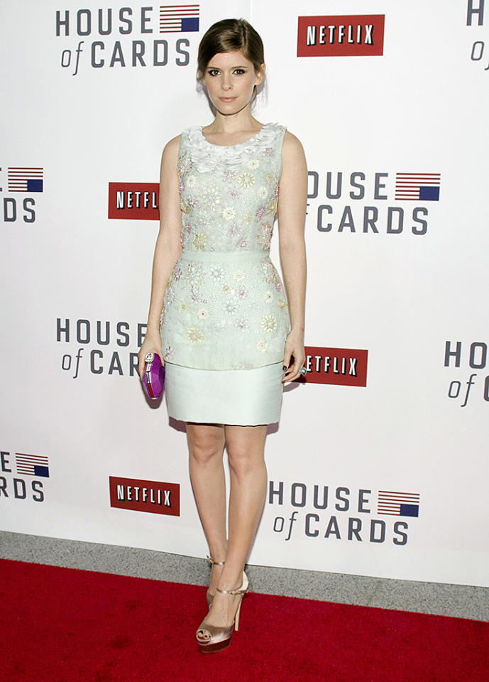 "WASHINGTON, DC - JANUARY 29: Kate Mara poses on the red carpet during the Netflix's ""House Of Cards"" Washington DC Screening at NEWSEUM on January 29, 2013 in Washington, DC. (Photo by Kris Connor/Getty Images)"