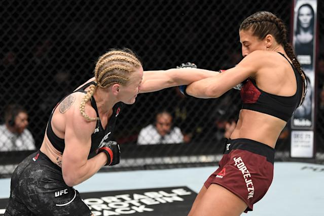 Valentina Shevchenko punches Joanna Jedrzejczyk in their UFC flyweight championship fight during UFC 231 at Scotiabank Arena on Dec. 8, 2018 in Toronto, Canada. (Getty Images)