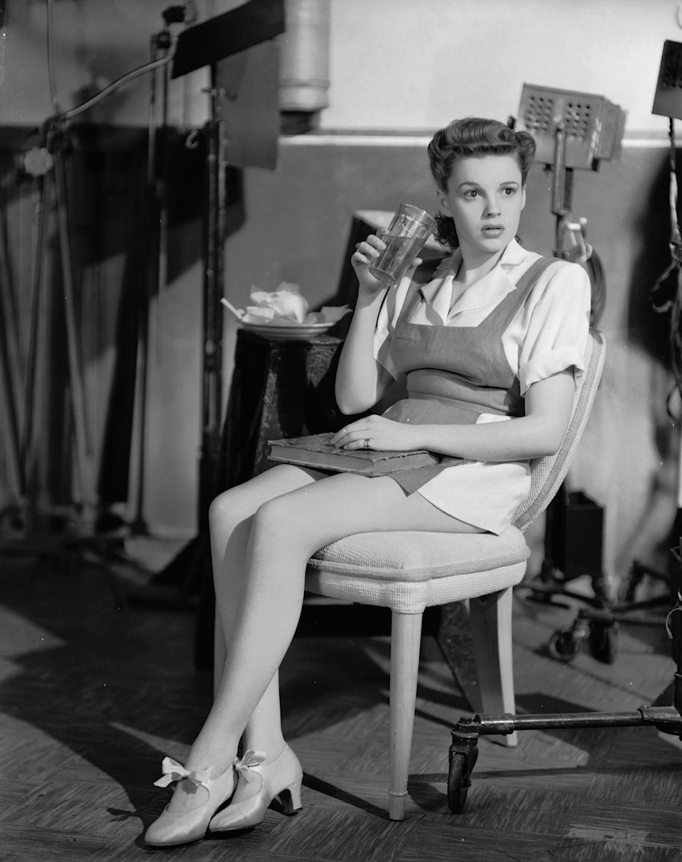 """Garland in tap shoes between takes on the set of the film """"Ziegfeld Girl."""""""