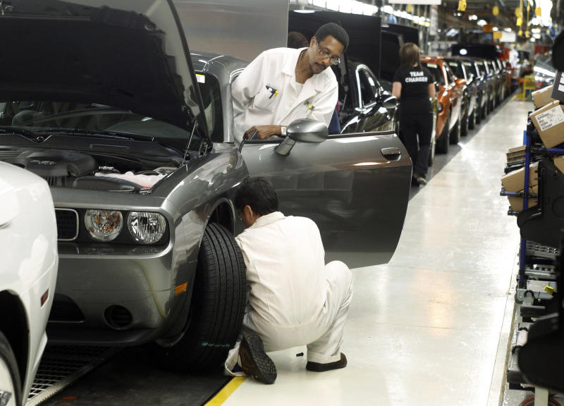Chrysler Group LLC employees work on the assembly line during the production launch of Chrysler vehicles at the assembly plant in Brampton (REUTERS)