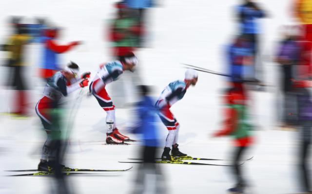 Cross-Country Skiing - Pyeongchang 2018 Winter Olympics - Men's 50km Mass Start Classic - Alpensia Cross-Country Skiing Centre - Pyeongchang, South Korea - February 24, 2018 - Martin Johnsrud Sundby of Norway in action ahead of compatriots Hans Christer Holund and Emil Iversen. REUTERS/Carlos Barria