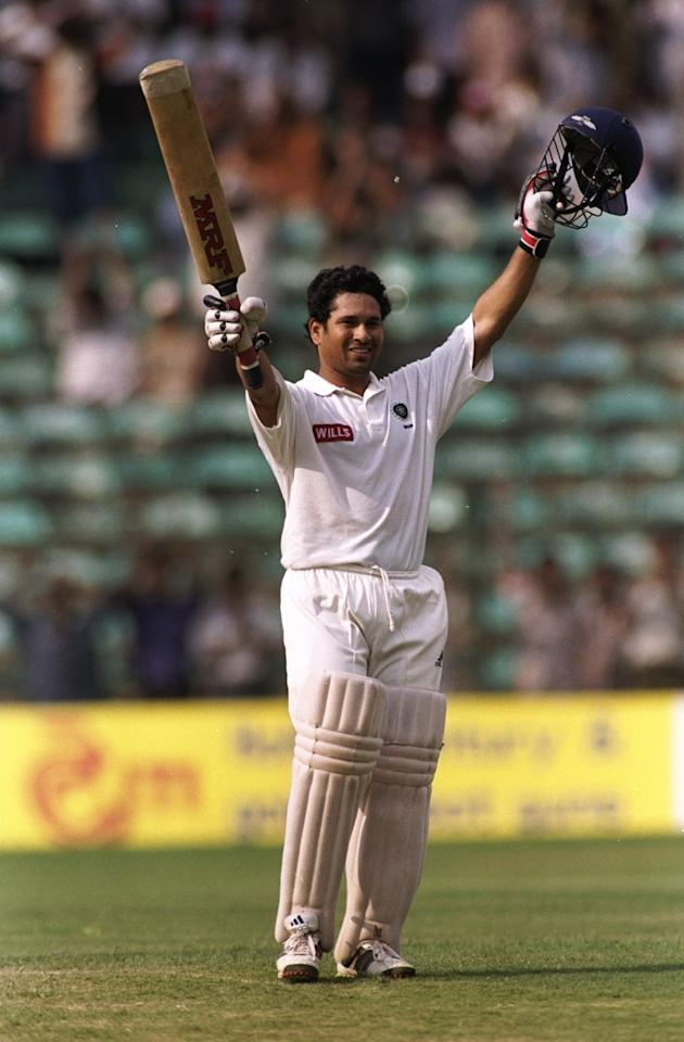 25 Mar 1998:  Sachin Tendulkar of India celebrates reaching the century mark during the third test between India and Australia played in Bangalore, India. Australia won the match by 8 wickets even though India defeated them 2-1 in the 3-Test competition.\ Mandatory Credit: Shaun Botterill /Allsport