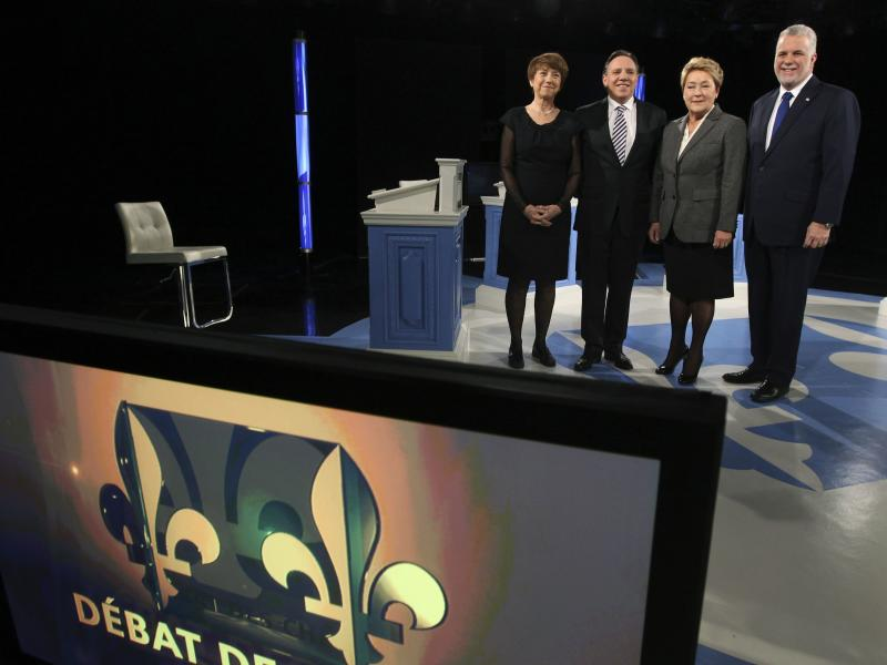 Leaders of Quebec's political parties pose for a picture prior to their debate in Montreal