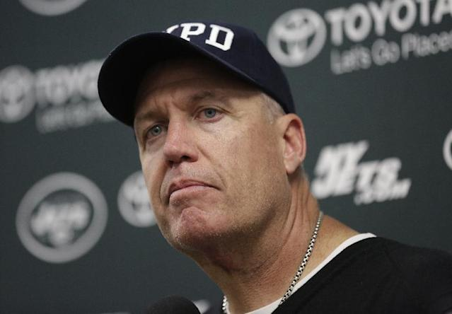 FILE - In this Sunday, Dec. 28, 2014, file photo, New York Jets head coach Rex Ryan listens to a questions during a news conference following an NFL football game against the Miami Dolphins, in Miami Gardens, Fla. Jets owner Woody Johnson fired Ryan and general manager John Idzik on Monday, Dec. 29, 2014, after one of the most disappointing seasons in franchise history. (AP Photo/Lynne Sladky, File)