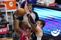 Philadelphia 76ers center Dwight Howard, left, shoots as Los Angeles Clippers center Ivica Zubac defends during the first half of an NBA basketball game Saturday, March 27, 2021, in Los Angeles. (AP Photo/Mark J. Terrill)