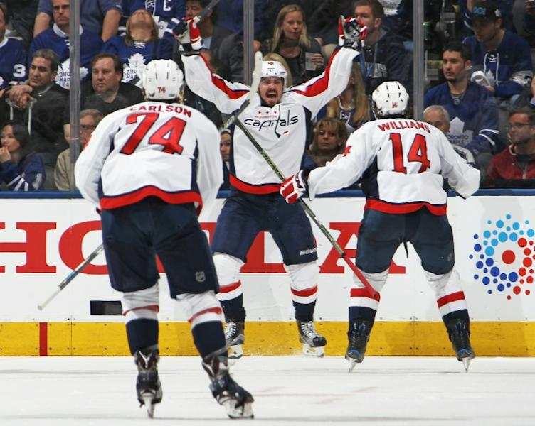 Marcus Johansson (C) of the Washington Capitals celebrates after scoring the overtime and series-winning goal against the Toronto Maple Leafs in Game Six of the Eastern Conference quarter-finals, in Toronto, on April 23, 2017