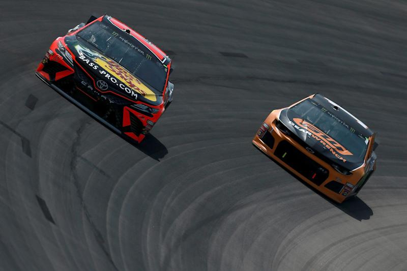 FORT WORTH, TX - MARCH 31: Martin Truex Jr., driver of the #19 Bass Pro Shops Toyota, leads Kurt Busch, driver of the #1 GEARWRENCH Chevrolet, during the Monster Energy NASCAR Cup Series O'Reilly Auto Parts 500 at Texas Motor Speedway on March 31, 2019 in Fort Worth, Texas. (Photo by Sean Gardner/Getty Images)