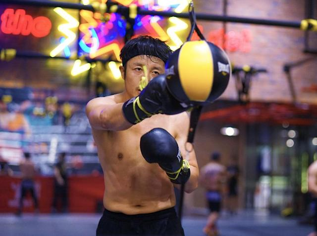 Zou Shiming, shown training in July, sought immediate hospital treatment last month after suddenly losing much of the sight in his left eye (AFP Photo/STR)