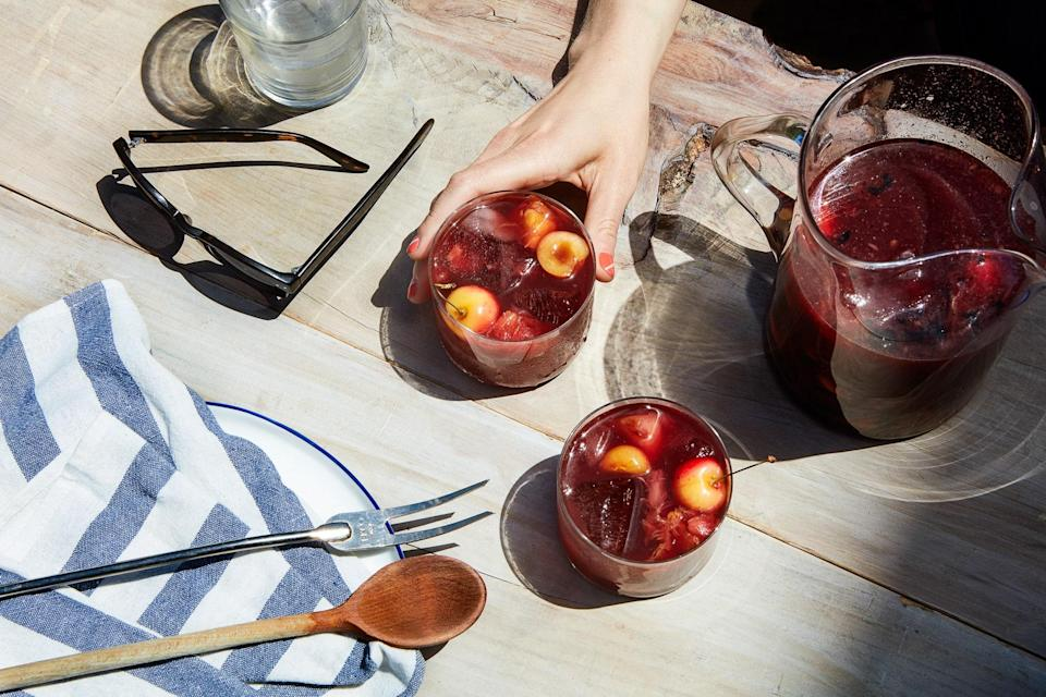 "Sangria doesn't have to be a sugary mess. Grilled stone fruit adds a natural caramelized sweetness to this refreshing drink. <a href=""https://www.epicurious.com/recipes/food/views/grilled-stone-fruit-sangria?mbid=synd_yahoo_rss"" rel=""nofollow noopener"" target=""_blank"" data-ylk=""slk:See recipe."" class=""link rapid-noclick-resp"">See recipe.</a>"