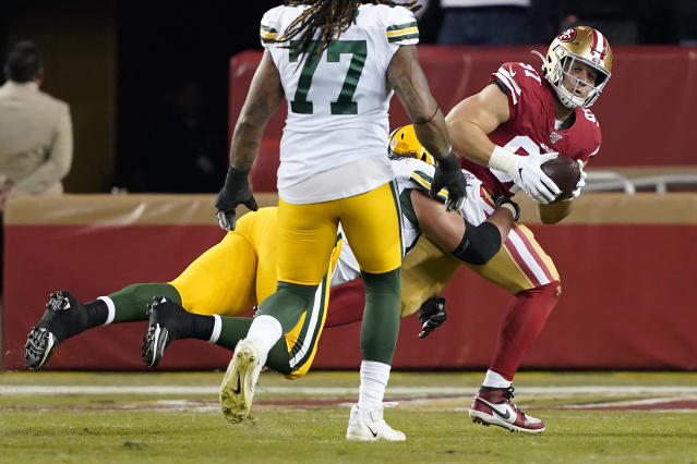 San Francisco 49ers defensive end Nick Bosa, right, is tackled by Green Bay Packers offensive tackle David Bakhtiari after recovering a fumble during the first half of an NFL football game in Santa Clara, Calif., Sunday, Nov. 24, 2019. (AP Photo/Tony Avelar)