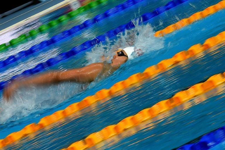 Vietnam's Thi Anh Vien Nguyen competes in the women's 200m backstroke swimming final of the 29th Southeast Asian Games in Kuala Lumpur (AFP Photo/Manan VATSYAYANA)