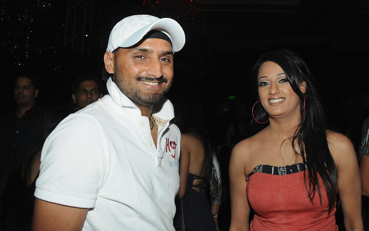 MUMBAI, INDIA - MARCH 13: Harbhajan Singh with actress and model Vrinda Parekh at the IPL Nights after party following the 2010 DLF Indian Premier League T20 group stage match between the Mumbai Indians and the Rajasthan Royals at the Oberoi Trident on March 13, 2010 in Mumbai, India.  (Photo by Yogen Shah-IPL 2010/IPL via Getty Images)