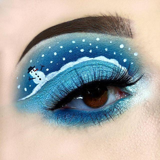 """<p>Draw a snowy scene with a tiny Frosty on the outside of your lid as a nod to the classic holiday story. </p><p><a class=""""link rapid-noclick-resp"""" href=""""https://www.amazon.com/Eyeshadow-Afflano-Pigmented-Waterproof-Shimmery/dp/B07TTL47W6/?tag=syn-yahoo-20&ascsubtag=%5Bartid%7C10050.g.34534998%5Bsrc%7Cyahoo-us"""" rel=""""nofollow noopener"""" target=""""_blank"""" data-ylk=""""slk:SHOP BLUE EYESHADOW PALETTES"""">SHOP BLUE EYESHADOW PALETTES</a></p><p><a href=""""https://www.instagram.com/p/B521b02IOeI/?utm_source=ig_embed&utm_campaign=loading"""" rel=""""nofollow noopener"""" target=""""_blank"""" data-ylk=""""slk:See the original post on Instagram"""" class=""""link rapid-noclick-resp"""">See the original post on Instagram</a></p>"""