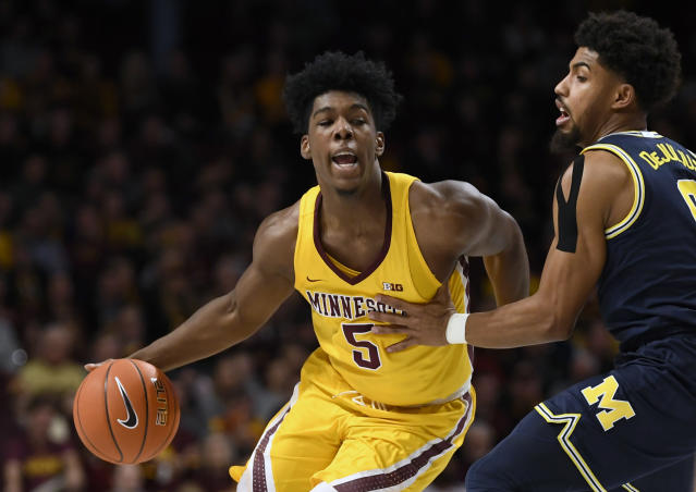 Michigan's David DeJulius, right, guards against Minnesota's Marcus Carr (5) in the first half during an NCAA college basketball game on Sunday, Jan. 12, 2020, in Minneapolis. (AP Photo/Hannah Foslien)